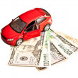 Stock Photo: Toy car and money over white. Rent, buy or insurance car concept
