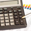 Business picture: calculator, financial graphs, pen — Stock Photo