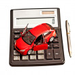 Toy car and calculator over white. Rent, buy, repair or insuranc - Stock Photo