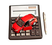 Toy car and calculator over white. Rent, buy, repair or insuranc — Stock Photo