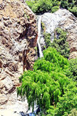 Beautiful view of waterfall in mountains in sunny day — Stock Photo