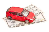 Toy car and money over white. Rent, buy or insurance car concept — Stock Photo