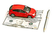 Car, pen and money — Stock Photo