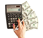 Calculator and money in woman's hands — Stock Photo