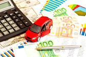 Toy car, money and other business staff — Stock Photo