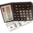 Stock Photo: Business picture: money and calculator over white