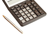 Business picture: calculator and pen isolated on white backgroun — Stock Photo