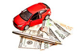 Toy car, key and money over white. Rent, buy or insurance car co — Stock Photo