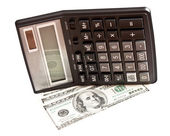 Business picture: money and calculator over white — Stock fotografie