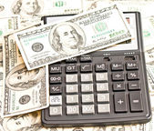 Business picture: money and calculator — Stock Photo