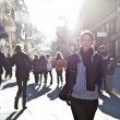 Urban girl striding through city area - Foto de Stock  