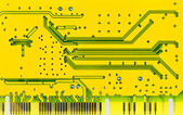 Close up of a yellow computer microcircuit — Stock Photo