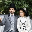 Old-fashioned dressed couple in park — Stock Photo #28219539