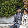 Old-fashioned dressed couple in park — Stock Photo #28219747