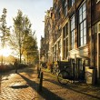 Wonderful and idyllic street scene at sunset in amsterdam. — Stock Photo #28716671