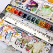 Picture of messy, used aquarelle paintbox — Stock Photo