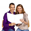 Young couple in love reading together a brochure with blank cover pages — Stock Photo
