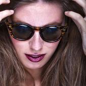 Fashion portrait of young and stylish woman — Stock Photo