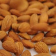 Stock Video: Falling almonds