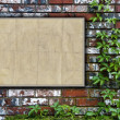 Stock Photo: Brick Wall With Bulletin Board