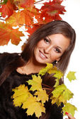 Portrait of beautiful girl with autumn leaves — Stock Photo