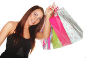 Happy woman with bags and gifts — Stock Photo