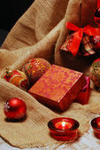 Christmas still life with presents and candles — Stock Photo
