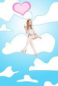 Beautiful woman on wing love — Stock Photo