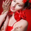 Bright flamenko model with red flowers in hair — Stock Photo