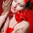Bright flamenko model with red flowers in hair — Stock Photo #23861637