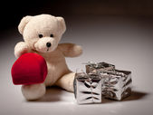 Teddy bear with romantic gift — Stock Photo
