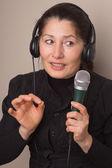 Woman with earphones — Stockfoto