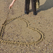 Heart written on the sand — Stock Photo