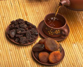 Dried fruits and tea — Stock Photo