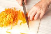 Carrots cutting — Stock Photo