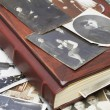 Close up of an album and ancient family photos — Stock Photo #23394764