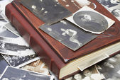 Close up of an album and ancient family photos — Stock Photo