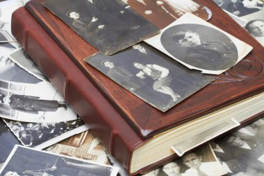 Close up of an album and ancient family photos