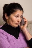 Asian woman talking on the phone — Stock Photo