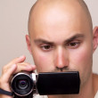 Young man wearing a picture using a camera — Stock Photo