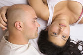 Vertical image of a couple lying head to head — Stock Photo