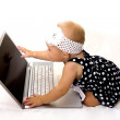 Cute baby with a laptop. — Stock Photo