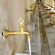 Antique Turkish faucet on wall — Stock Photo