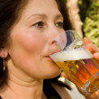 Woman drinks beer — Stock Photo