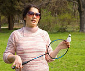 Woman playing badminton — Stock Photo