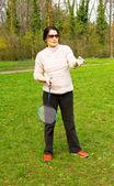 Woman playing badminton — Stock Photo