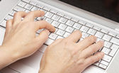 Female hands printing on the keypad a laptop — Stock Photo