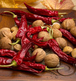 Best natural spices of pepper, walnuts,almonds. — Stock Photo