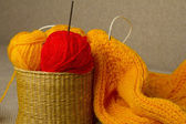 Multicolored yarn in wicker basket — Stockfoto