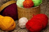 Multicolored yarn in wicker basket — Stock Photo